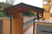 copri cancello in legno lamellare