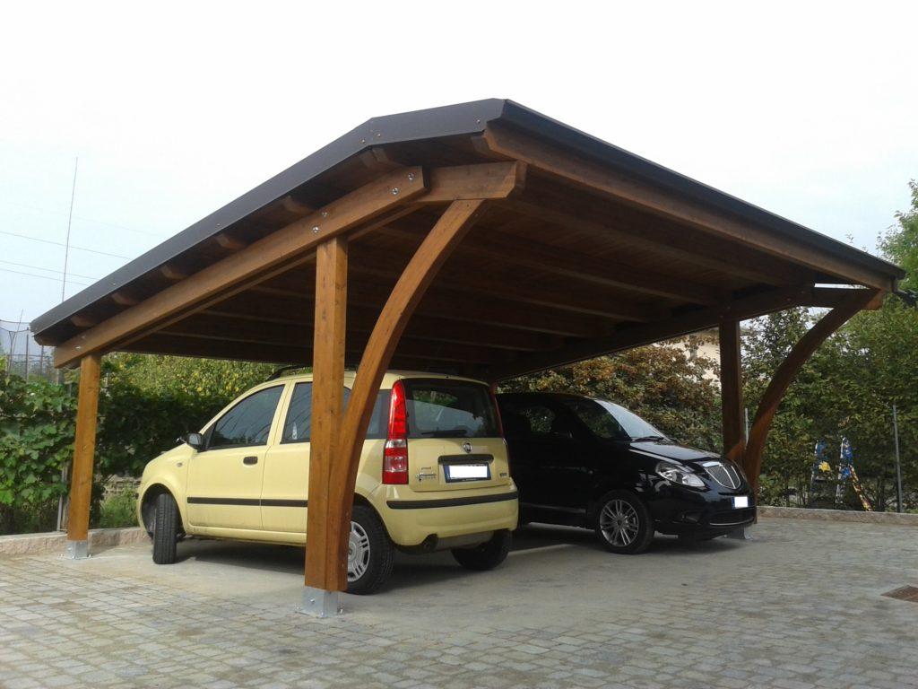posto auto con archi in legno lamellare